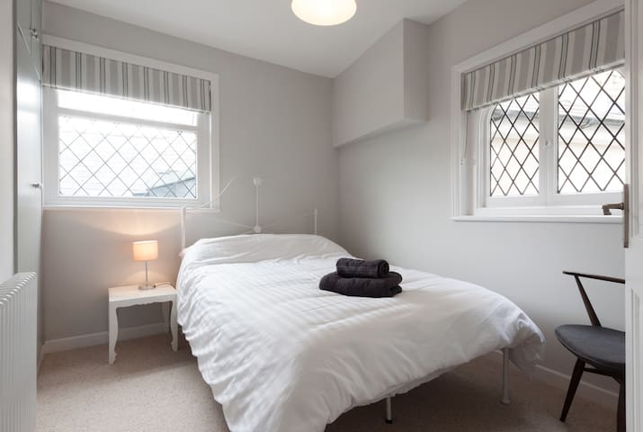 Smaller bedroom with pretty windows, blackout blinds and John Lewis small double bed.