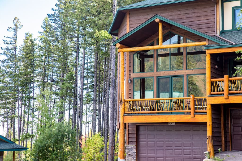 Large windows overlooking the Mountain as your drive up to the property