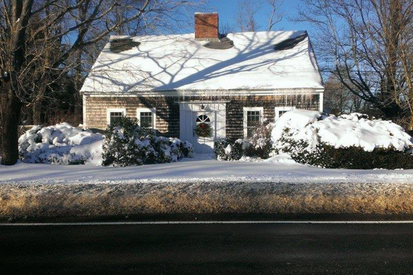 The front of the house  as seen from Rt. 6a after a winter snowfall.