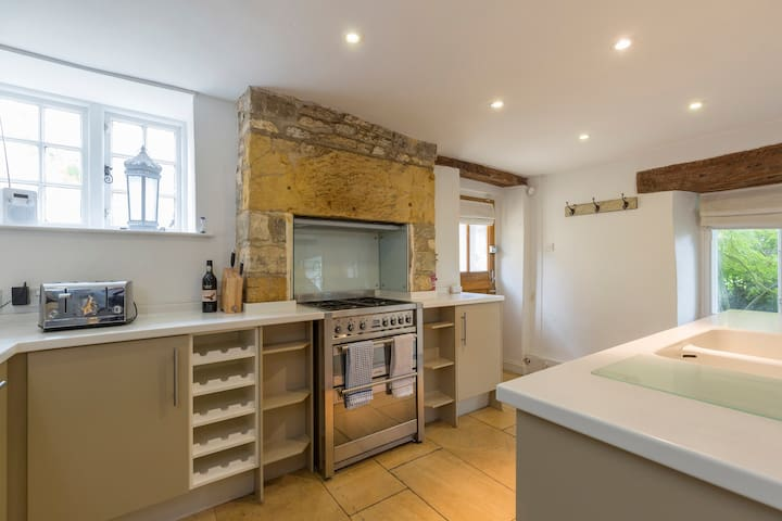 Gas range cooker in well-equipped kitchen