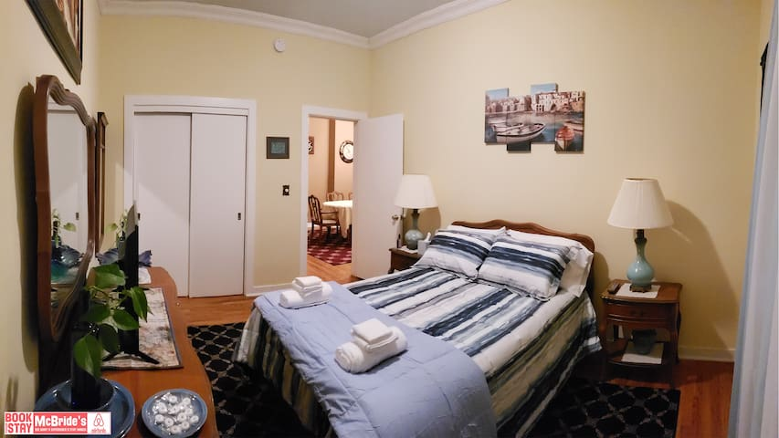 The blue master bedroom with large closet..  Visit our Facebook page for a full 360 Tour of Mcbride's Airbnb.