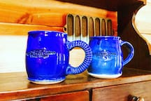 Limited Edition The Granbury Cabins Mug - $20 Take a piece of vacation home with you. Handcrafted by a local artisan and hand-stamped with our logo. Each mug is a work of art and no two mugs are exactly the same. Dishwasher, microwave safe. Let us know if you would like one or two and we will add it to your stay!