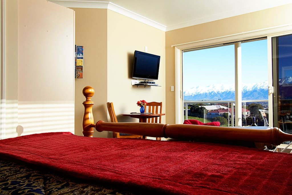 A stunning view of our snow capped mountains from the bed.