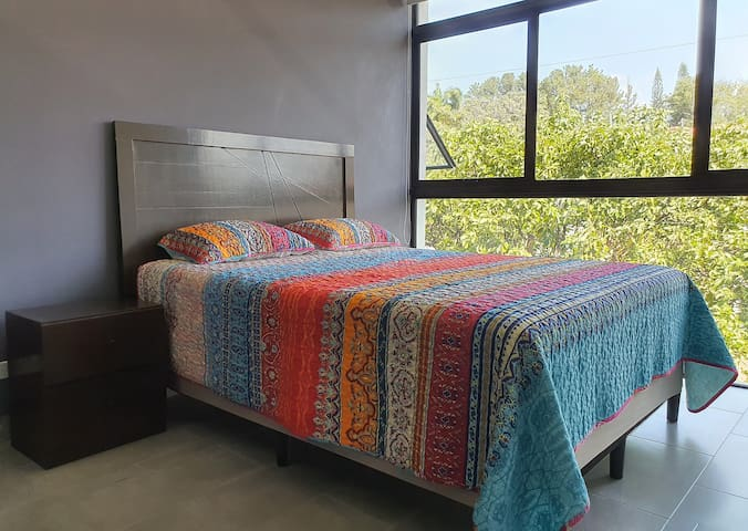 Master Bedroom with Queen Size Bed. Very luminous space and quite confortable with it's own Air Conditioning. Walk in closet and private bathroom.