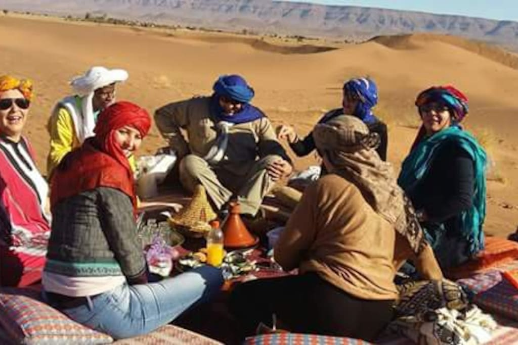breakfast in big largest dune in north africa border with algeria