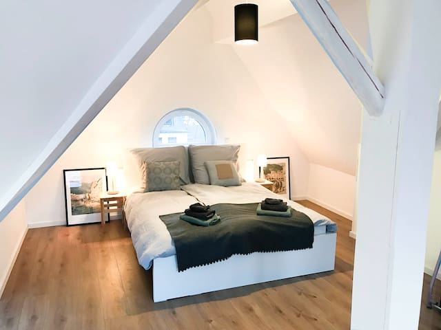 Large attic loft with private bath/shower