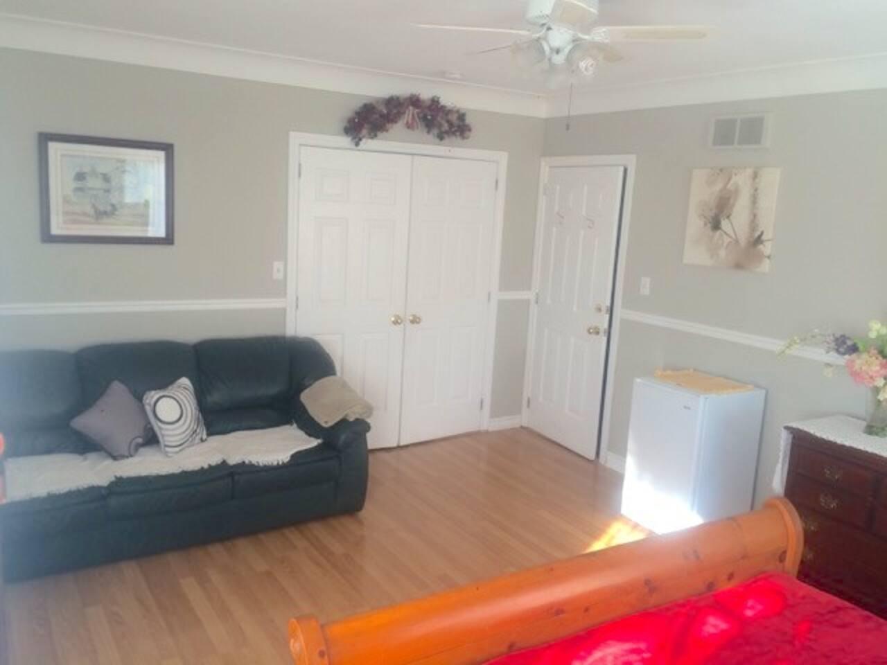 Couch, Mini Fridge, Closet, Drawer set, Hardwood floor
