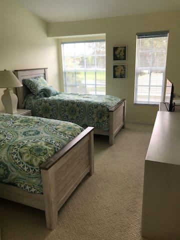 Guest bedroom overlooking 17th hole fairway.