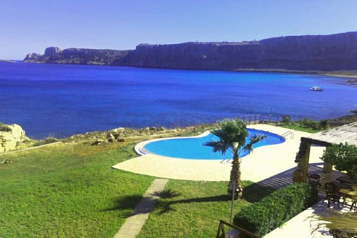 An amazing beachfront Mansion with  a pool /lindos