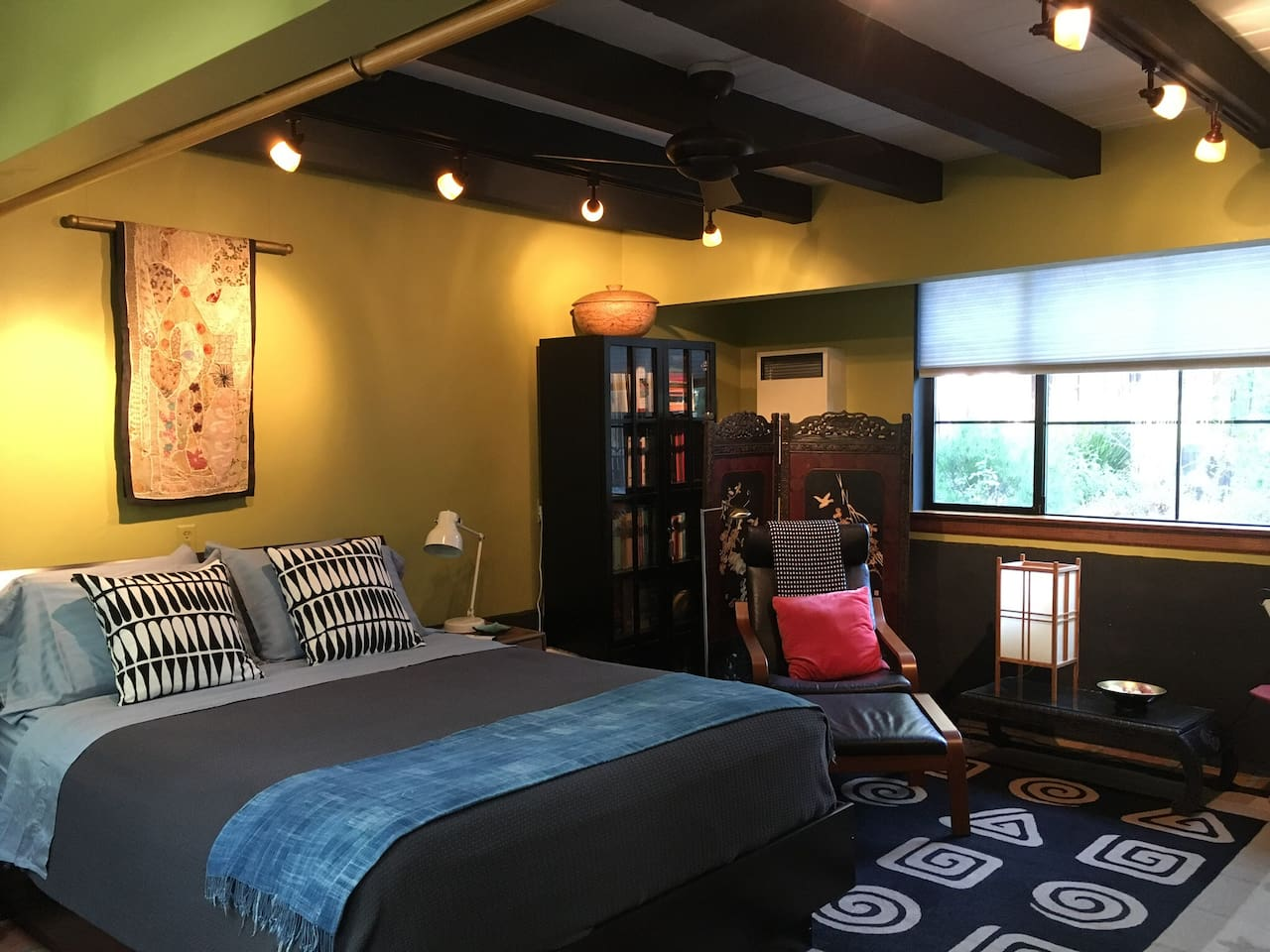 Spacious 21' x 14' guest room with queen bed (and a single low roll-out bed for third adult or child, upon request.)