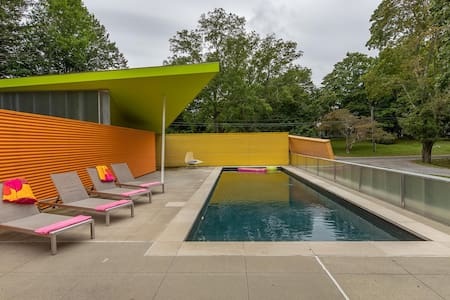 New Listing: Technicolor Paradise, Architectural Masterpiece Amidst Woodlands & Beaches, and Heated Pool