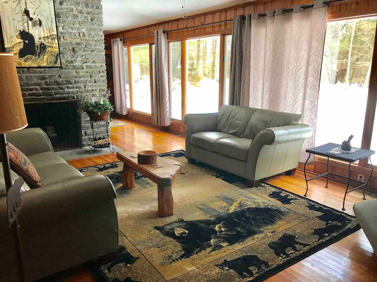 The living room is bright, spacious and has plenty of seating. The full wall of ceiling to floor windows overlooks the wooded yard, where you will enjoy the sights and sounds of nature.
