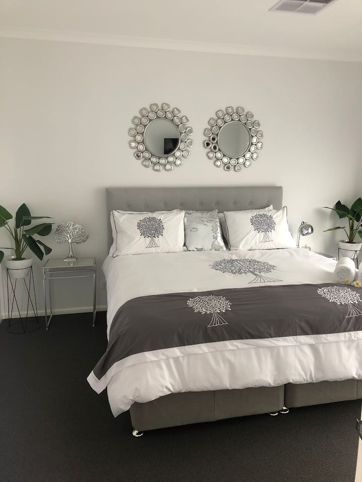 Master bedroom with private ensuite and walk in robe