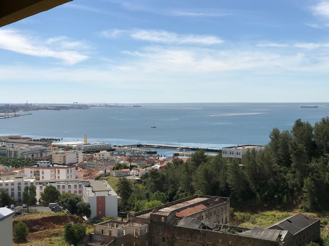 View from my balcony over Setúbal old town, the fishing harbour and the Sado River.