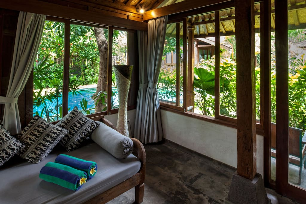 Comfortable space by the poolside... sofa can be used as single bed