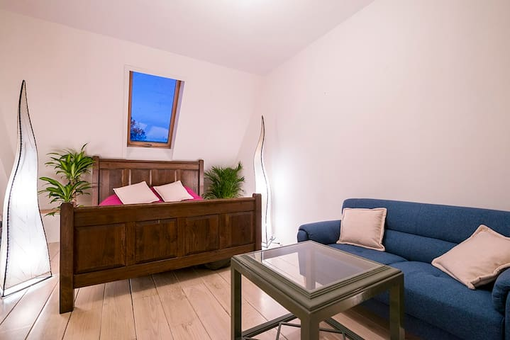 Spacious room with ensuite bathroom, has a couch and shelves for storage, space for a desk too.