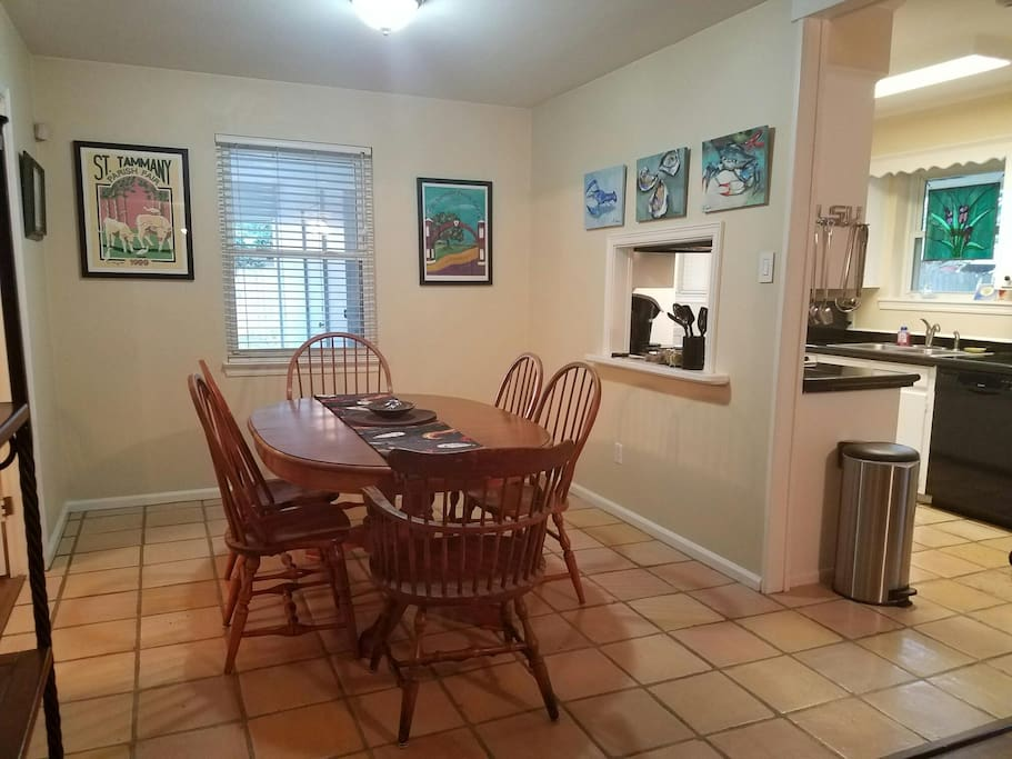 Large and spacious dining area with table with leaves, seats six or more; pass-through from kitchen which is immediately adjacent to dining area.