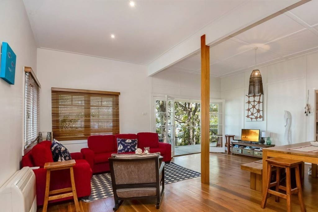 The spacious open plan living area with flat screen tv