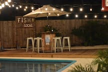 The perfect area to enjoy a meal or have a conversation poolside.