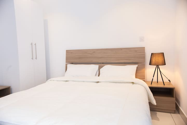 Double size bed and anti-allergy bedding (pillows and duvet).