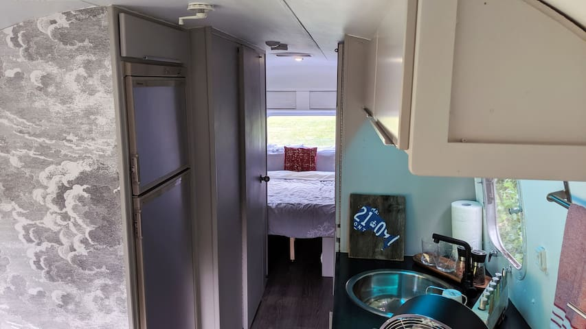 The two single beds at the back of the classic Airstream have been update to a King sized, memory foam bed!