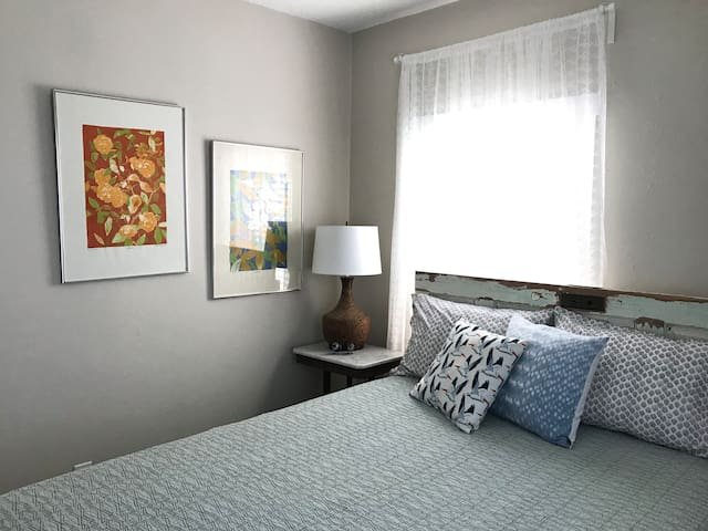 Light and bright bedroom with queen bed