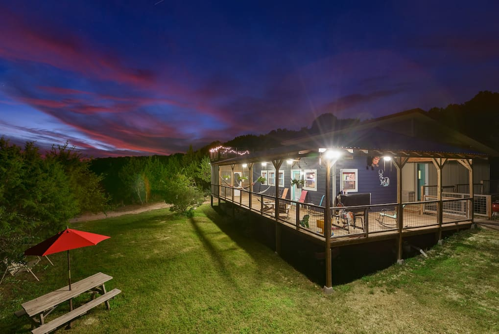 With the wrap around porch, spacious property, bbq, hammocks, rooftop deck and hot tub, this is truly a vacation home!