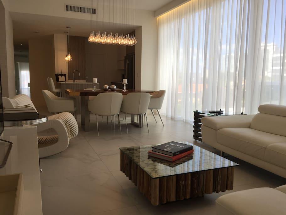 designer furnished living room and dining area