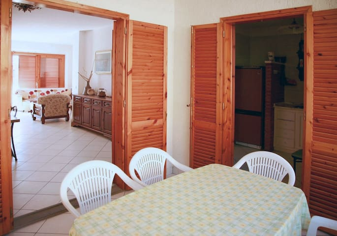 Living room and kitchen opening to the balcony ...