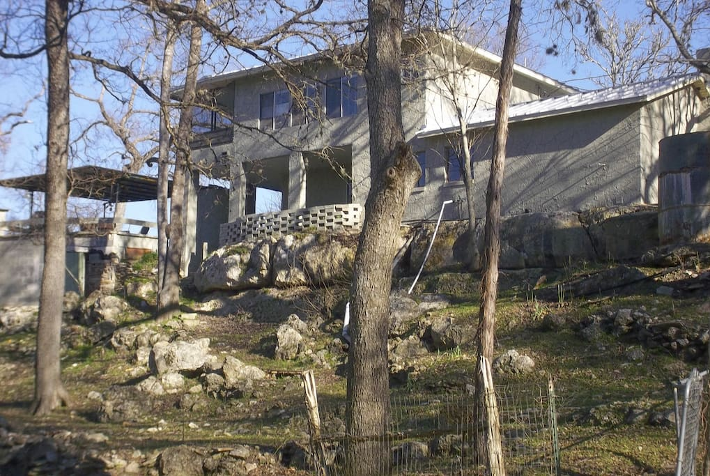 Creekside of home on rock bluff above the Sabinas. Covered patios and area where deer and squirrels entertain guests.