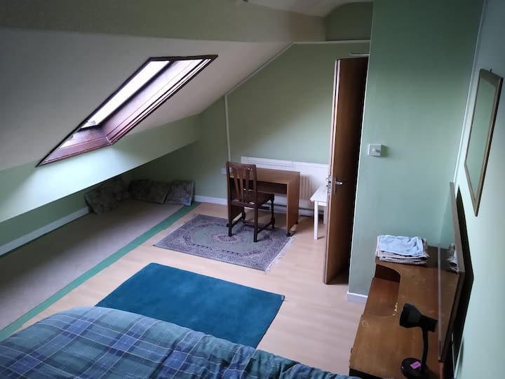 Light double attic room in central Levenshulme