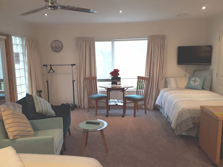 Spacious living area with King Single Bed for additional guest