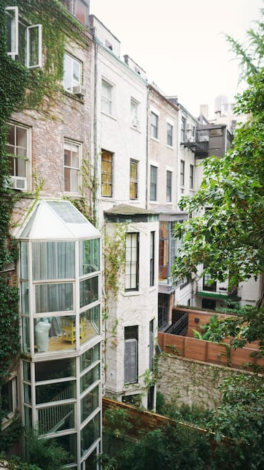 The living room and bedroom windows look out over the courtyards of the neighboring brownstones.