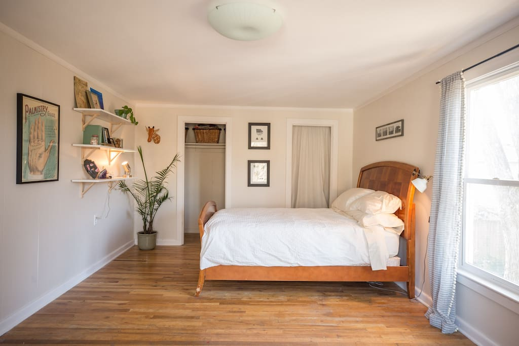 The rock room has a queen size bed with a down comforter and a closet for hanging your things.