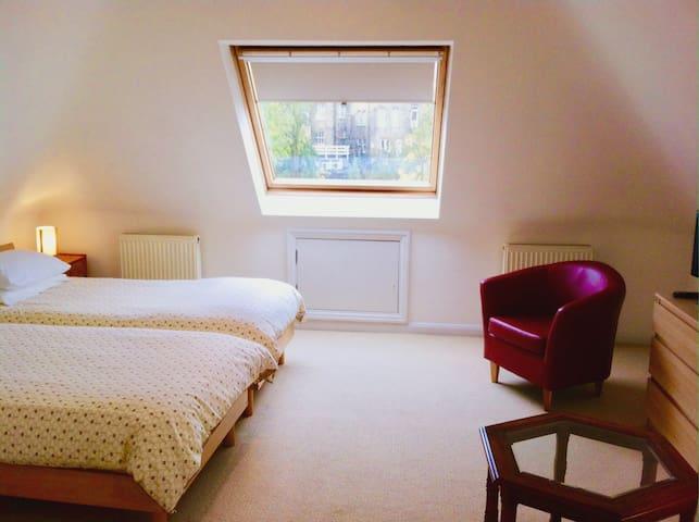 Spacious loft twin bedroom with own bathroom