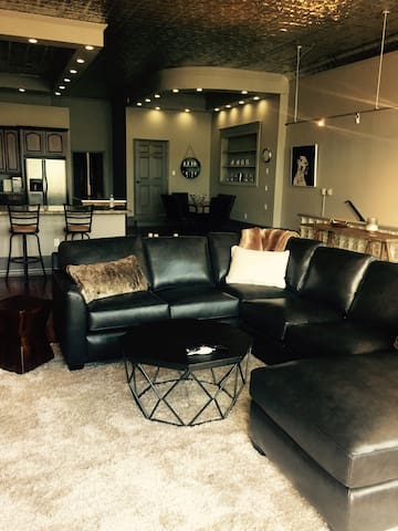 Full grain leather sectional, open floor plan