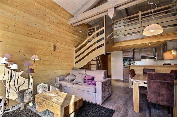 Beautiful renovated duplex, facing south close to slopes