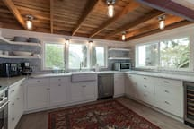 Elegant retreat with private hot tub & gourmet kitchen, minutes from the beach