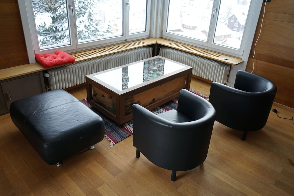 Living room with an amzing view over Andermatt
