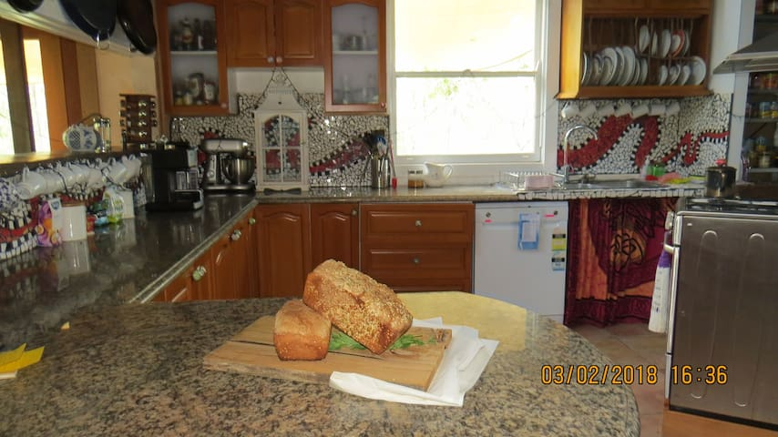 Full kitchen with Coffee machine and loaf of fresh bread on arrival