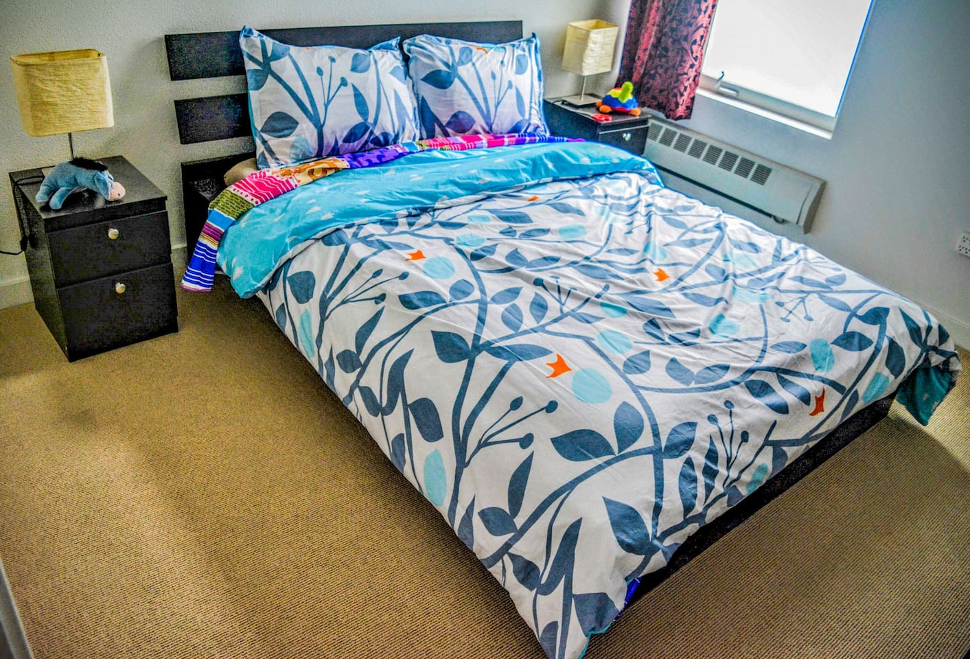 Guest bedroom with a comfortable full bed (54 inches x 74 inches). I change the sheets/covers regularly, so it may look different than in this photo when you arrive - available to book