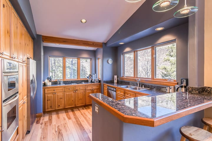 Granite counters gleam in the natural light from all the windows