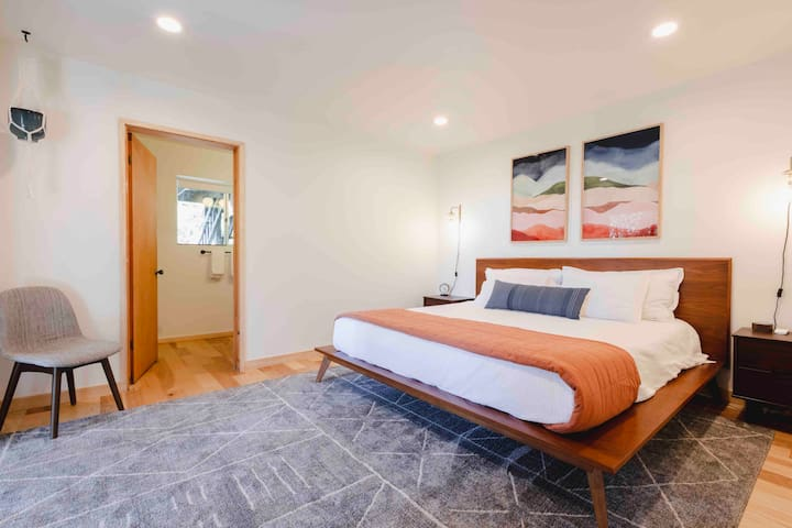 This spacious suite includes an adjacent bathroom with tub and it's own private deck.