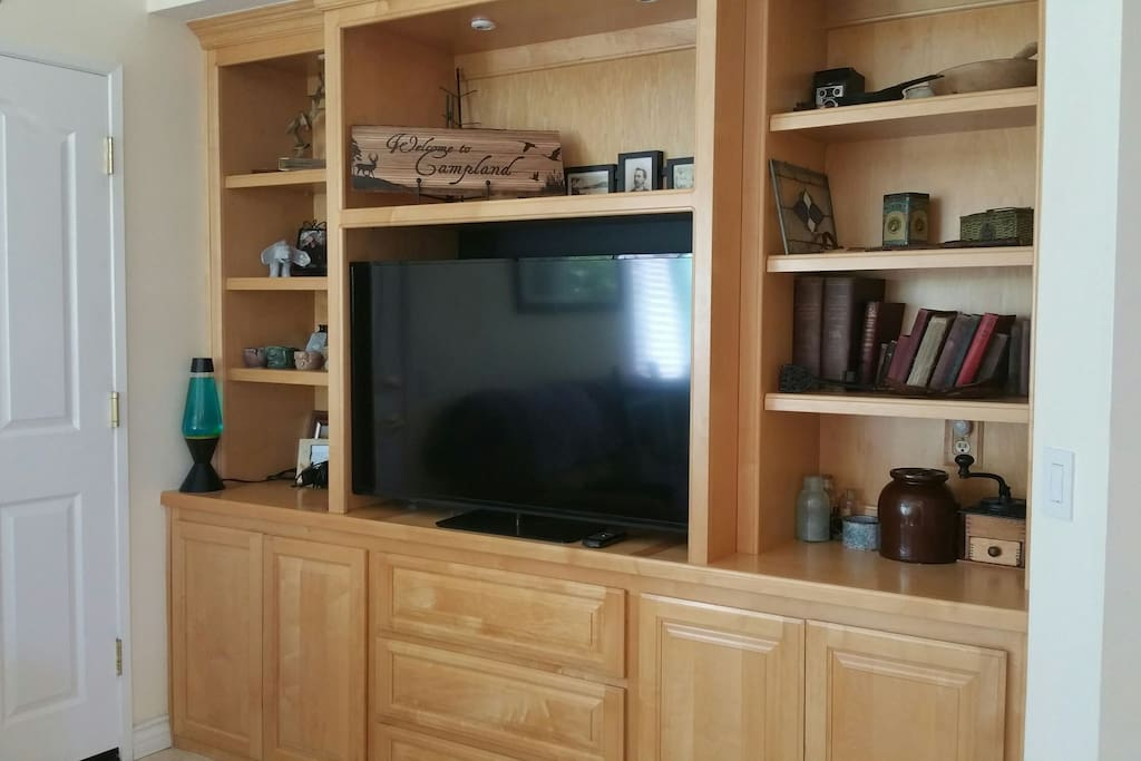 Off kitchen by pullout sofa and recliner