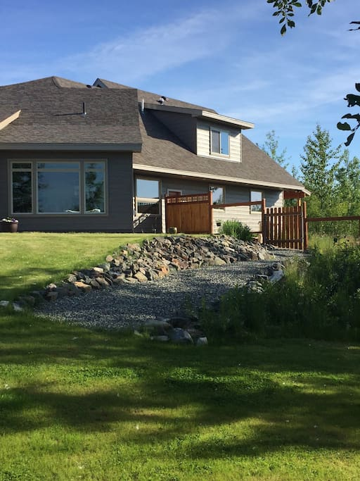 Rental Apartment has privacy gate and gravel path leading to yard and lake