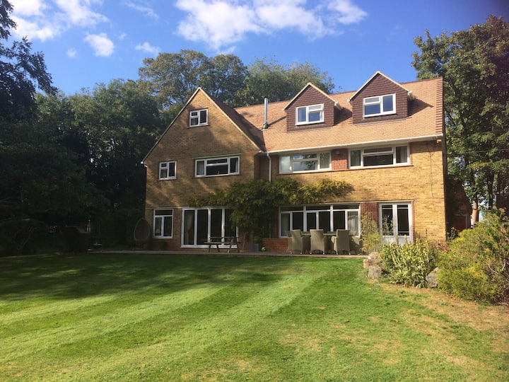 A beautiful family village home with tennis court