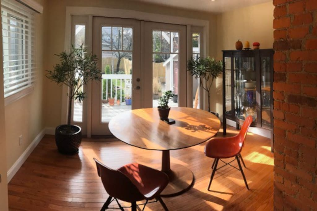 Dining room overlooking garden and deck (table seats 6, 6 matching chairs  :) )