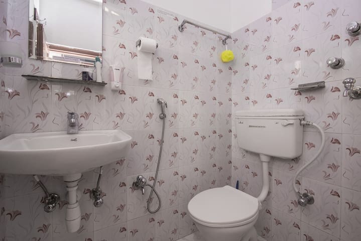 Ensuite bathroom. You can maintain the temperature of the hot shower.