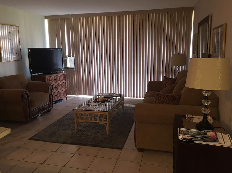 Living room with flat screen TV WiFi and cable. Directions for remotes on coffee table