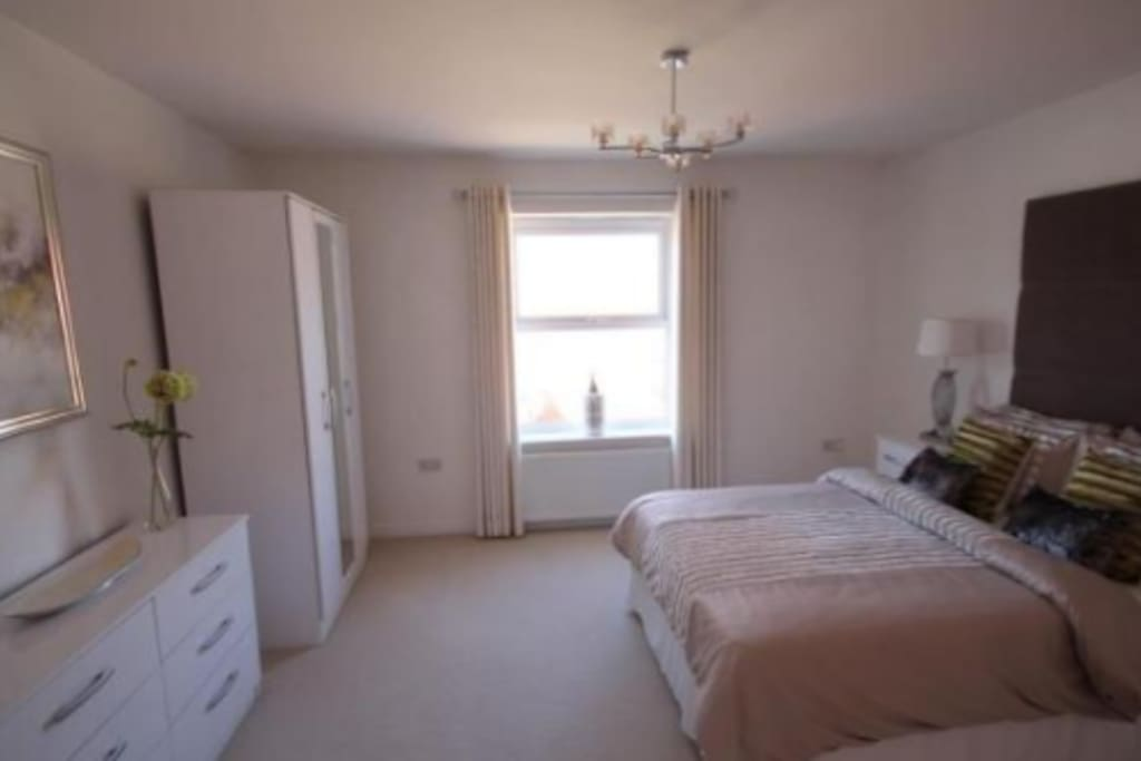 Bedroom 2. Has garden view. Large double bed with wardrobe.